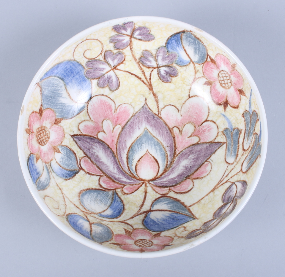 """Lot 10 - A Midwinter bowl, designed by Nancy Great-Rex, decorated in a floral pattern, 8"""" wide"""
