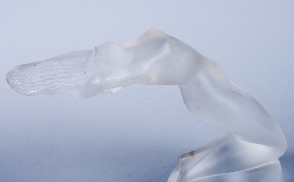 "Lot 50 - A Lalique frosted glass figure of a female nude, ""Chrysis"", on a circular foot, etched mark and"