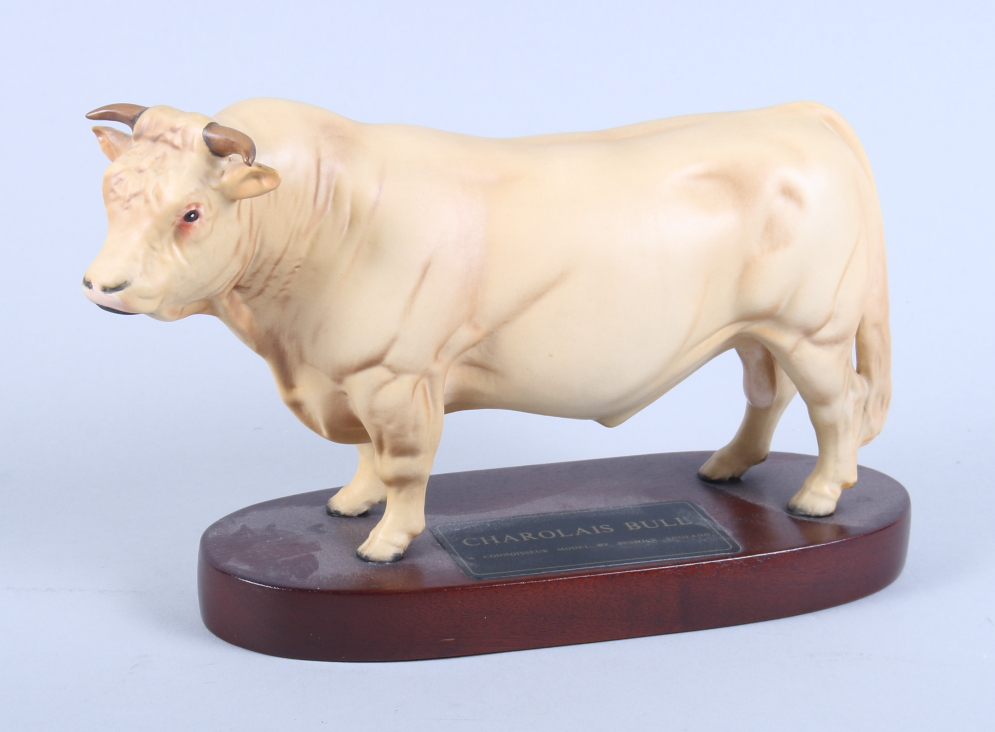 Lot 43 - A Beswick Connoisseur model of a standing Charolais bull with matt finish, on an oval wooden base,
