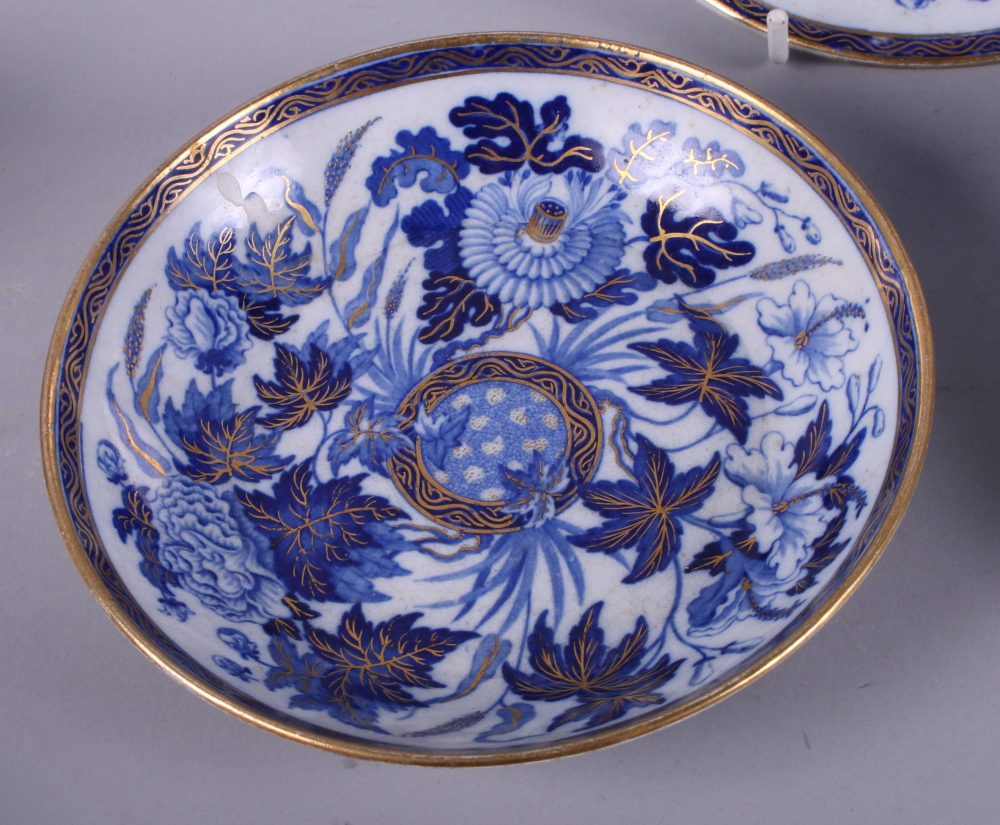 Lot 2 - A pair of early 19th century Wedgwood pottery blue and white floral decorated tea cups and saucers