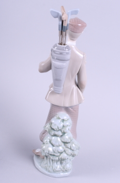 "Lot 29 - A matched pair of Lladro figures, golfers carrying clubs in bags over shoulder, each 12"" high"