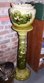 "Lot 36 - A Leeds Art Pottery jardiniere stand decorated blossom on a green ground, 33"" high, and a"