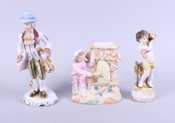 Lot 26 - A Continental figure of a boy holding a conch shell, a similar figure of a gentleman with a fiddle