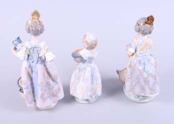 "Lot 28 - Three Lladro figures, ""Valencian Girl"", Miss Valencia"" and ""Making Paella"", tallest 8 3/4"" high"