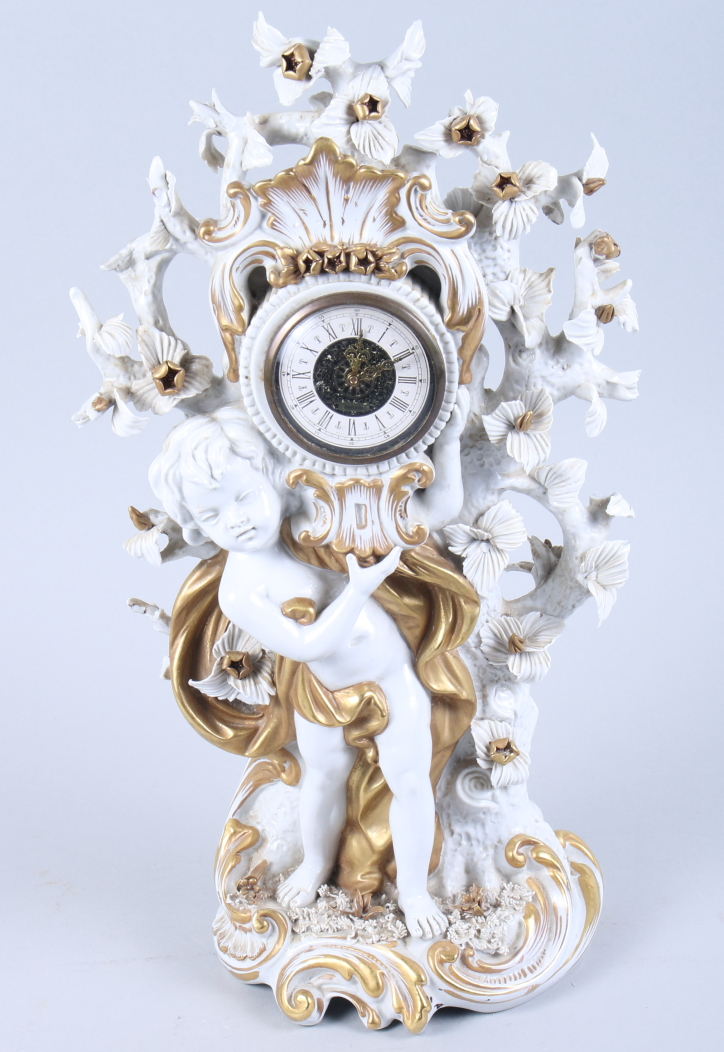 """Lot 7 - A Capodimonte gilt decorated porcelain mantel clock with putto support, 15"""" high"""