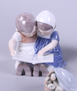 """Lot 33 - A Lladro figure group of two Inuit children riding a polar bear, 7"""" high, a similar figure of a"""