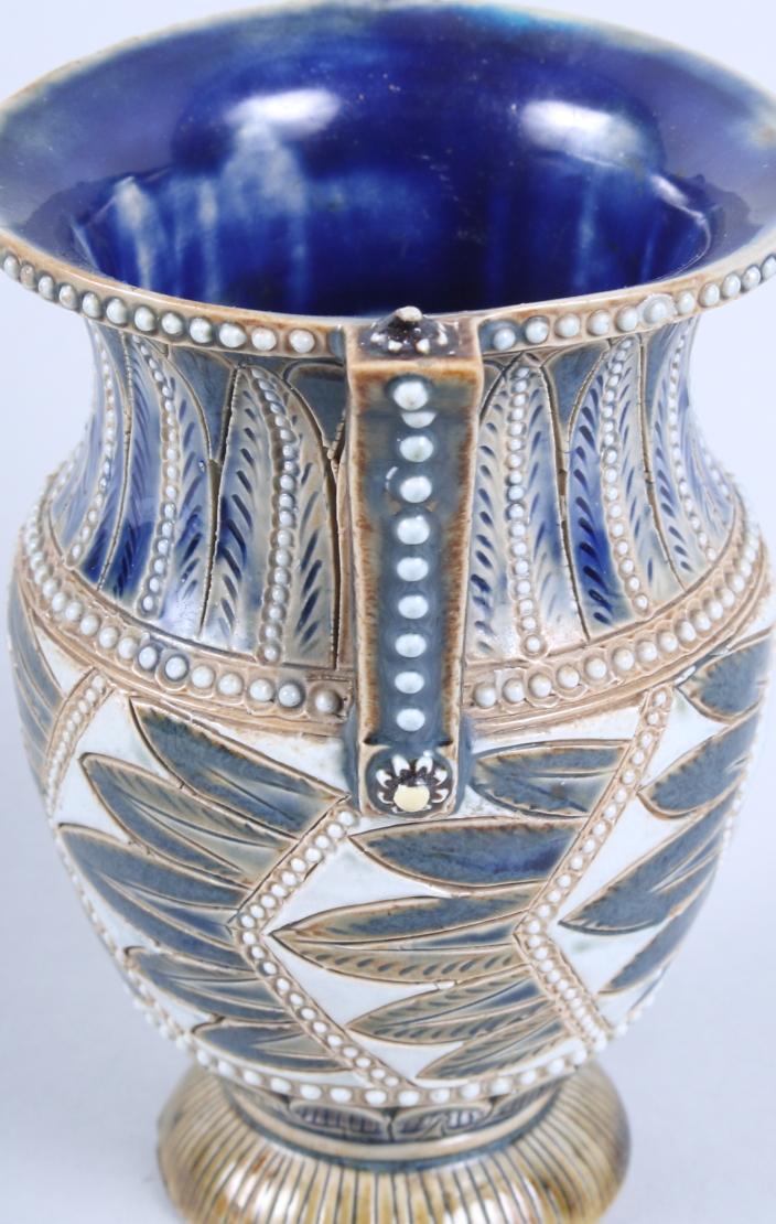 """Lot 57 - A Doulton Lambeth two-handled urn-shaped vase, 5"""" high"""