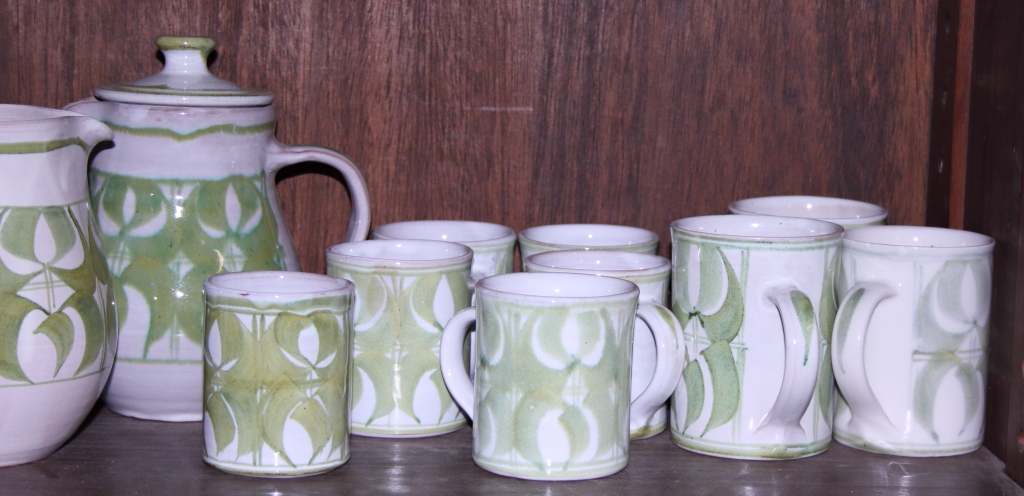 Lot 60 - An Aldermaston pottery coffee set for six, three mugs, a matching teapot and a milk jug, decorated