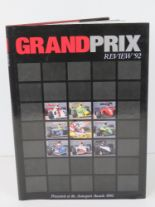 Lot 10 - Book; Grand Prix Review 1992, hardback with dust wrapper, signed by Nigel Mansell.