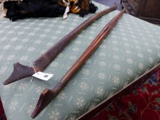 TWO ANTIQUE EASTERN BOW FORM SHOULDER YOKES.