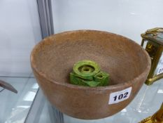 AN EARLY RED STONEWARE DEEP BOWL AND AN EASTERN GREEN GLAZED POTTERY OIL LAMP