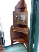 "A RARE 19TH ARTS AND CRAFTS CORNER CABINET- "" THE ANGLE CABINET"" DESIGNED BY E.W.GODWIN AND MOST"