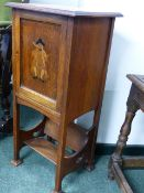 AN ARTS AND CRAFTS SMALL OAK SMOKER'S CABINET WITH BOOK TROUGH BELOW.