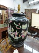 A CHINESE FAMILLE MOIRE BALUSTER FORM VASE WITH FIGURAL DECORATION MOUNTED AS A LAMP ON A CARVED