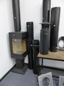 A GOOD QUALITY MODERN WOOD BURNER BY NORDPEIS COMPLETE WITH FLUE, CHIMNEY, BRACKETS AND COWLS, IN