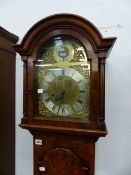 A 20th.C.WALNUT CASED LONGCASE CLOCK WITH ARCH BRASS DIAL SIGNED GARRARD, SILVER CHAPTER RING AND