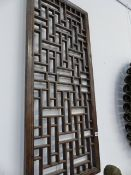 AN ORIENTAL LATTICE WINDOW PANEL.