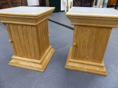 A PAIR OF HARDWOOD PEDESTAL CABINETS.