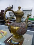 A LARGE ANTIQUE TIBETAN BRASS AND COPPER LIDDED KETTLE.