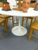 A MID CENTURY TULIP BASE DINING TABLE BY ARKANA IN THE STYLE OF SAARINEN