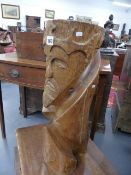 A CARVED WOOD FIGURE OF A CROWNED KING WITH INDISTINCT INSCRIPTION.