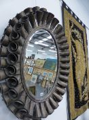 A CONTEMPORARY PAIR OF METAL FRAMED OVAL MIRRORS.