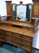 AN ARTS AND CRAFTS OAK DRESSING TABLE BY SHAPLAND & PETTER. W.123cms.