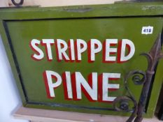 A HAND PAINTED SIGN WITH WROUGHT IRON BRACKET, STRIPPED PINE.