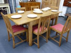 A HEAL'S PALE OAK EXTENDING DINING TABLE TOGETHER WITH A SET OF SIX SIMILAR HEAL'S OAK DINING