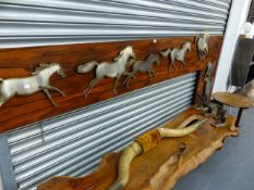 A LARGE MID CENTURY ROSEWOOD AND CUT STEEL DISPLAY GALLOPING HORSES.
