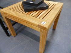 A SMALL HARDWOOD PATIO COFFEE TABLE.