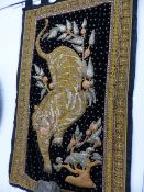 AN EASTERN EMBROIDERED WALL HANGING OF A TIGER. 172 x 104cms.