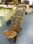 A CARVED AFRICAN THRONE CHAIR.
