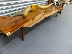 A LARGE NATURAL FORM WOOD PLANK COFFEE TABLE.