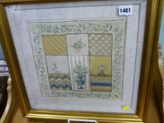 A FRAMED PETIT POINT AND MULTI STITCH SAMPLER.