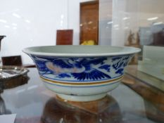 A CHINESE BLUE AND WHITE FLARED FORM FOOTED BOWL WITH DRAGON AND PHOENIX DECORATION, SIX CHARACTER