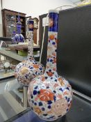 A PAIR OF JAPANESE IMARI BOTTLE FORM VASES. H.25cms.