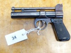A VINTAGE WEBLEY JUNIOR AIR PISTOL WITH SPECIAL ORDER ENGRAVED DECORATIONS