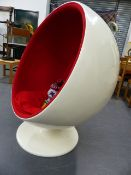 A LARGE MID CENTURY BALL CHAIR.IN THE STYLE OF EERO AARNIO