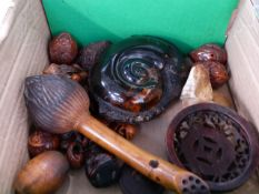 A JAPANESE CARVED BOXWOOD LOTUS BUD , TWO FINELY CARVED WALNUT SHELL NETSUKI, A SIMILAR BEAD /