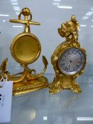 A VICTORIAN GILT METAL FRENCH STYLE WATCH STAND IN THE FORM OF AN ANCHOR TOGETHER WITH A MINIATURE