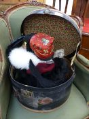 A COLLECTION OF VARIOUS VINTAGE LADIES HATS CONTAINED IN A LEATHER BOUND HAT BOX.