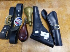 AN ANTIQUE LEATHER SHOT FLASK, A BRASS POWDER FLASK, TWO WESTERN STYLE LEATHER HOLSTERS AND BELTS.