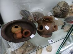 A LARGE GROUP OF ROMAN AND ANCIENT POTTERY VESSELS AND FRAGMENTS, TWO MARBLE STATUE FRAGMENTS AND