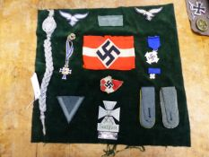 A COLLECTION OF GERMAN NAZI PERIOD MILITARY BADGES, ARMS BANDS, MEDALS ETC TOGETHER WITH A WWII