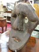 AN UNUSUAL INUPIK CARVED WOOD MASK.