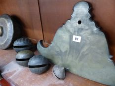 A LARGE BRONZE TIBETAN PANEL GONG TOGETHER WITH FOUR BRASS BELLS, A FURTHER EASTERN GONG