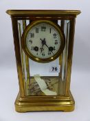 A LATE VICTORIAN/EDWARDIAN BRASS CASED FOUR GLASS TABLE CLOCK WITH 8-DAY MOVEMENT STRIKING ON