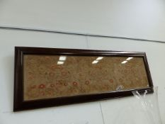 AN ARTS AND CRAFTS NEEDLEWORK PANEL OF FLOWERS IN A WALNUT BOLLECTION TYPE FRAME. OVERALL H.60 x W.