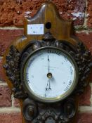 A VICTORIAN CAST IRON CASED WALL CLOCK/BAROMETER THERMOMETER ON OAK BACKBOARD SIGNED J J